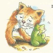 Eine kleine Katze kuschelt sich...